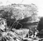 Japanese 120mm gun protuding from a cave opening, Iwo Jima, Japan, circa Mar 1945