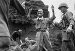 Japanese troops being captured by Americans on Iwo Jima, Japan, 5 Apr 1945