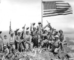 US Marines posing with the second flag atop Mount Suribachi, Iwo Jima, Japan, 23 Feb 1945