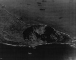 View of the southwestern face of Mount Suribachi, Iwo Jima, Japan, 7 Mar 1945; photo taken from an aircraft of USS Anzio