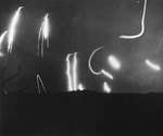 Star shells fired from American warships illuminated Iwo Jima battlefield to prevent Japanese night attacks, Feb 1945