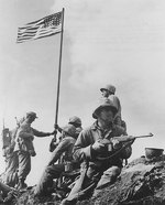 Men of 28th Regiment, US 5th Marine Division putting up the first flag on Mount Suribachi, Iwo Jima, Japan, at 1020 hours on 23 Feb 1945; note M1 Carbine