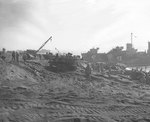 Scene on a Iwo Jima beach, as supplies were unloaded and trucked inland, circa late Feb 1945