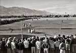 Japanese-American internees of the Manzanar War Relocation Camp playing a game of baseball, California, United States, circa 1943