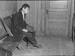 Japanese-American Toshi Mizoguchi waiting at a Wartime Civil Control Administration station to register for evacuation, Byron, California, United States, 28 Apr 1942