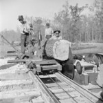 Men working at a saw mill, Jerome War Relocation Center, Arkansas, United States, 16 Nov 1942, photo 1 of 2