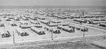 View of the War Relocation Authority camp, looking northwest from the hospital, near Jerome, Arkansas, United States, 17 Nov 1942, photo 1 of 2