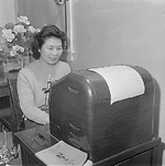 A female Japanese-American stenographer at the Jerome Relocation Center, Arkansas, United States, 11 Mar 1943