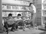 Japanese-American boys reading comic books in Tule Lake Relocation Center, Newell, California, United States, 1 Jul 1942