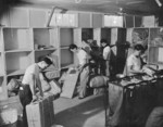 Japanese-Americans working at the post office inside of Jerome War Relocation Center, Arkansas, United States, 17 Nov 1942