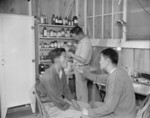Japanese-Americans Dr. K. H. Taria and pharmacist Tom Arase at work, Jerome War Relocation Center, Arkansas, United States, 17 Nov 1942