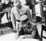 Xu Yongchang signing the surrender document on behalf of China aboard USS Missouri, Tokyo Bay, Japan, 2 Sep 1945, photo 3 of 5