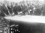 Lieutenant General Hiroshi Nemoto surrendering his sword at the Japanese surrender ceremony at the Forbidden City, Beiping, China, 10 Oct 1945