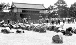 Japanese civilians listening to Emperor Showa