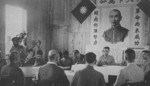 Lieutenant General Xiao Yisu speaking with the local Japanese surrender delegation, Zhijiang, Hunan Province, China, 21 Aug 1945, photo 2 of 2