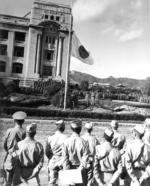 Japanese flag being lowered during the surrender ceremony at the General Government Building, Seoul, Korea, 9 Sep 1945