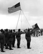 Raising the US flag over Wake Island after Japan