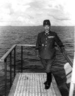 Lieutenant General Shunzaburo Mugikura aboard Portland to surrender Truk, Caroline Islands, which is visible in background, 2 Sep 1945
