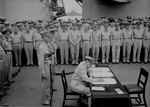 MacArthur signing Japanese surrender aboard USS Missouri, 2 Sep 1945, photo 4 of 4