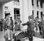 Lieutenant General F. W. Messervy of Malaya Command receiving the sword of General Itagaki of Japanese 7th Area Army at a formal ceremony of surrender, Victoria Institution, Kuala Lumpur, Malaya, 22 Feb 1946