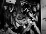 US Navy African-American enlisted sailors aboard USS Ticonderoga celebrating upon hearing the news of Japanese surrender, 14 Aug 1945