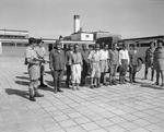 Accused Japanese war criminals under guard while awaiting transfer to Stanley Prison, Hong Kong, 29 Sep 1945