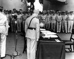 Xu Yongchang signing the surrender document on behalf of China aboard USS Missouri, Tokyo Bay, Japan, 2 Sep 1945, photo 1 of 5