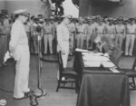 General Umezu signing the instrument of surrender, Tokyo Bay, Japan, 2 Sep 1945, photo 3 of 4