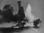 HMS Exeter under attack during the Second Battle of the Java Sea, 1 Mar 1942, photo 1 of 2
