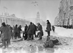 Citizens of Leningrad, Russia fetching water from a shell hole in Ostrovsky Square, 1 Dec 1941