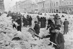 Citizens of Leningrad, Russia cleaning rubbles off a street, 8 Mar 1942