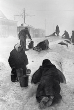 Civilians of Leningrad fetching water from a broken water pipe, Russia, Dec 1941-Jan 1942