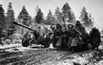 Soviet field guns and troops on a muddy road near Leningrad, Russia, 1 Nov 1941