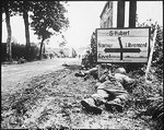 Men of the 8th Infantry Regiment attempted to move forward but were pinned down by German small arms from within the Belgian town of Libin, 7 Sep 1944