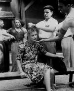 A French mob shaved the head of a French girl as punishment for having personal relations with a German soldier, Montélimar, France, 29 Aug 1944