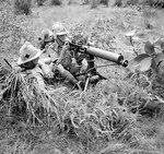 Vickers machine gun crew of the British 1st Manchester Regiment, Malaya, 17 Oct 1941