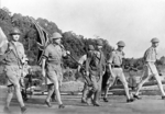 British Army Lieutenant General Arthur Percival and his party carrying the United Kingdom flag on their way to surrender Singapore to the Japanese, 15 Feb 1942, photo 1 of 2
