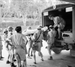 A British soldier wounded during fighting in Malaya was being put onto an ambulance in Singapore, circa Dec 1941 to Jan 1942