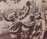Japanese troops disarming captured British soldier, Malaya, circa Dec 1941-Feb 1942