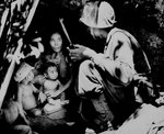 US Marine finding a family of five hiding in a cave during the fighting on Saipan, Mariana Islands, 21 Jun 1944