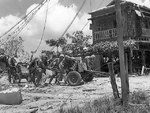 US Marines pushing a 37mm gun into position, Garapan, Saipan, Mariana Islands, 2 Jul 1944