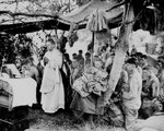 A US Navy chaplain holds mass for Marines killed during the Saipan landings, Jun 1944