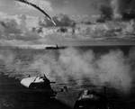 Japanese aircraft being shot down as it attempted to attack escort carrier Kitkun Bay, near Marianas Islands, Jun 1944, photo 1 of 2
