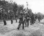Men of 2nd Regiment, 2nd Division, US Marine Corps coming off the front lines after 20 days of combat, Saipan, Mariana Islands, 5 Jul 1944