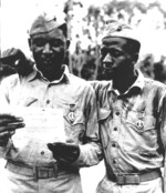 African-American US Marines Staff Sergeant Timerlate Kirven and Corporal Samuel J. Love, Sr. having just been awarded Purple Heart medals, Saipan, Mariana Islands, 1944
