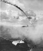 Japanese aircraft being shot down as it attempted to attack escort carrier Kitkun Bay, near Marianas Islands, Jun 1944, photo 2 of 2