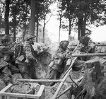 Four men of the 1st Paratroop Battalion, British 1st Airborne Division, took cover in a shell hole outside Arnhem, Netherlands, 17-25 Sep 1944