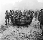 British infantry carrying assault boats in preparation for crossing the Meuse-Escaut canal at Lille-St Hubert, Belgium, 19 Sep 1944