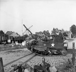 A heavily loaded Universal carrier during the advance of the British 3rd Division, the Netherlands, 19 Sep 1944