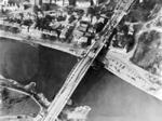 Aerial view of the bridge over the Nederrijn, near Arhnem, the Netherlands, circa 19 Sep 1944; note British troops and armored vehicles at north end of the bridge